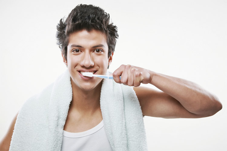 Guy brushing teeth daily