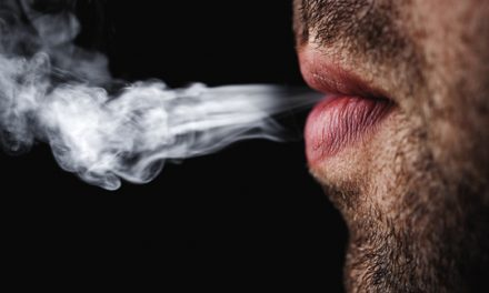 How does smoking affect oral health?