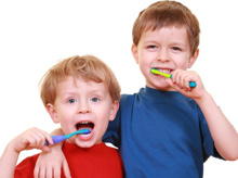 boys brushing their teeth