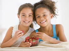 girls eating strawberries