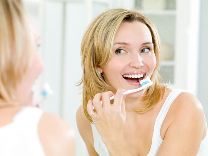 Happy woman brushing